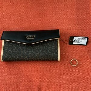Guess clutch with costume jewelry size 7 logo ring